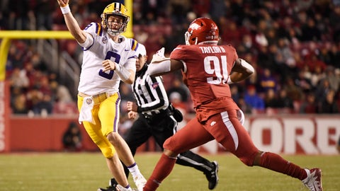 <p>               LSU quarterback Joe Burrow throws a pass over Arkansas defender Michael Taylor II during the first half of an NCAA college football game, Saturday, Nov. 10, 2018, in Fayetteville, Ark. (AP Photo/Michael Woods)             </p>