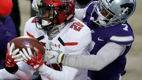 <p>               Texas Tech defensive back Adrian Frye (20) intercepts a pass intended for Kansas State wide receiver Isaiah Zuber (7) during the second half of an NCAA college football game in Manhattan, Kan., Saturday, Nov. 17, 2018. (AP Photo/Orlin Wagner)             </p>