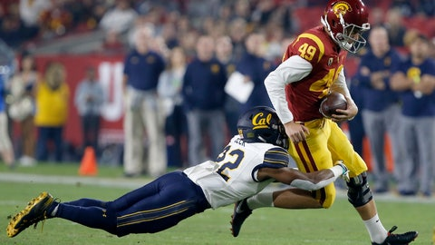 <p>               Southern California kicker Michael Brown, right, is pulled down by California' Traveon Beck, left, on a fake field goal during the first half of an NCAA college football game in Los Angeles, Saturday, Nov. 10, 2018. (AP Photo/Alex Gallardo)             </p>