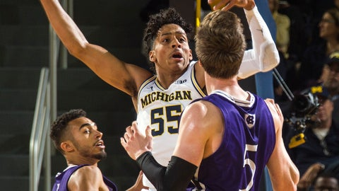 <p>               Michigan guard Eli Brooks (55) tries to intercept a pass from Holy Cross forward Connor Niego (5) to guard Kyle Copeland, left, during the first half of an NCAA college basketball game in Ann Arbor, Mich., Saturday, Nov. 10, 2018. (AP Photo/Tony Ding)             </p>