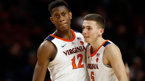 <p>               Virginia guards De'Andre Hunter, left, and Kyle Guy embrace in the final moments of an NCAA college basketball game against Maryland, Wednesday, Nov. 28, 2018, in College Park, Md. Virginia won 76-71. (AP Photo/Patrick Semansky)             </p>