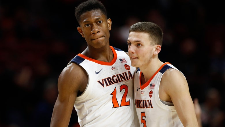 Guy scores 18, No. 4 Virginia outlasts No. 24 Maryland