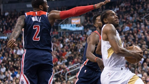 <p>               Toronto Raptors forward Kawhi Leonard drives past Washington Wizards guard John Wall (2) to score during the first half of an NBA basketball game Friday, Nov. 23, 2018, in Toronto. (Chris Young/The Canadian Press via AP)             </p>
