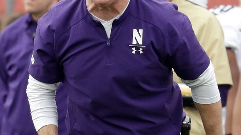<p>               FILE - In this Oct. 20, 2018, file photo, Northwestern head coach Pat Fitzgerald talks to his team during the first half of an NCAA college football game against Rutgers, in Piscataway, N.J. With the Big Ten West title wrapped up, No. 24 Northwestern could coast through the final two games, but coach Pat Fitzgerald isn't having it. The Wildcats play this week at Minnesota, where the Gophers need one more win for bowl-game eligibility. (AP Photo/Julio Cortez, File)             </p>