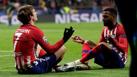 <p>               Atletico forward Antoine Griezmann, left, celebrates with his teammate Thomas Lemar after scoring his side's second goal during a Group A Champions League soccer match between Atletico Madrid and Monaco at the Metropolitano stadium in Madrid, Wednesday, Nov. 28, 2018. (AP Photo/Manu Fernandez)             </p>