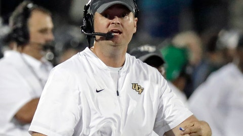 """<p>               FILE - In this Sept. 21, 2018, file photo, Central Florida head coach Josh Heupel directs his team against Florida Atlantic during the second half of an NCAA college football game n Orlando, Fla. No. 11 UCF, heavily favored to beat Navy to remain unbeaten and extend the nation's longest winning streak to 22 games, insists the Knights aren't paying attention to chatter about their chances of winding up in the College Football Playoff. """"We talk about it every day. ... Outside noise has no impact on what we are,""""  Heupel reiterated.  (AP Photo/John Raoux, File)             </p>"""