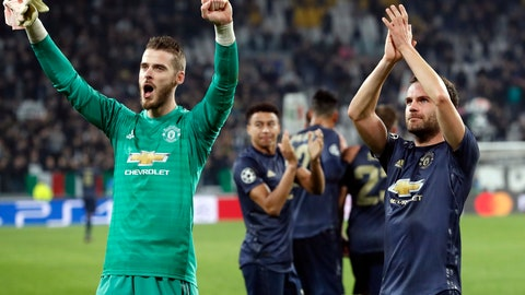 <p>               Manchester United's goalkeeper David de Gea, left, and Juan Mata celebrate at the end of the Champions League group H soccer match between Juventus and Manchester United at the Allianz stadium in Turin, Italy, Wednesday, Nov. 7, 2018. Manchester won 2-1. (AP Photo/Antonio Calanni)             </p>