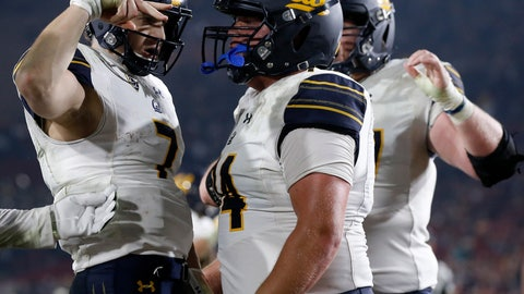 <p>               FILE - In this Saturday, Nov. 10, 2018, file photo, California quarterback Chase Garbers, left, celebrates with right guard Ryan Gibson after scoring a touchdown during the second half of an NCAA college football game against Southern California in Los Angeles. As big as beating USC was for Cal, a win over Stanford would be even more so. The Cardinal have won eight straight against the Golden Bears, many of them lopsided victories.  (AP Photo/Alex Gallardo, File)             </p>