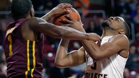 <p>               Minnesota's Dupree McBrayer (1) and Boston College's Wynston Tabbs (5) battle for a rebound during the first half of an NCAA college basketball game in Boston, Monday, Nov. 26, 2018. (AP Photo/Michael Dwyer)             </p>