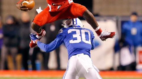 <p>               FILE - In this Saturday, Nov. 24, 2018, file photo, Utah quarterback Jason Shelley (15) hurdles BYU defensive back Keenan Ellis (30) in the first half of an NCAA college football game in Salt Lake City. One quality that teammates and coaches love about Utah quarterback Jason Shelley is his confidence. The moment is never too big for the redshirt freshman. (AP Photo/Rick Bowmer, File)             </p>