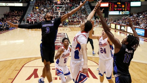 <p>               Buffalo's Jayvon Graves (3) and Jeenathan Williams (11) reach for a rebound along with Southern Illinois' Darius Beane (5), Marcus Bartley and Rudy Stradnieks (24) during the first half of an NCAA college basketball game Monday, Nov. 12, 2018, in Carbondale, Ill. (AP Photo/Jeff Roberson)             </p>