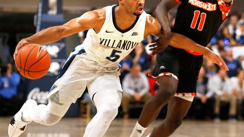 <p>               Villanova guard Phil Booth (5) moves past Morgan State guard Malik Miller (11) in the first half of an NCAA college basketball game, Tuesday, Nov. 6, 2018, in Villanova, Pa. (AP Photo/Laurence Kesterson)             </p>