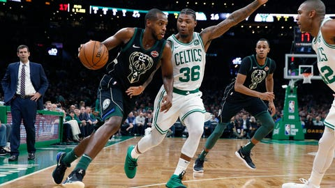 <p>               Milwaukee Bucks' Khris Middleton (22) drives past Boston Celtics' Marcus Smart (36) during the first half of an NBA basketball game in Boston, Thursday, Nov. 1, 2018. (AP Photo/Michael Dwyer)             </p>