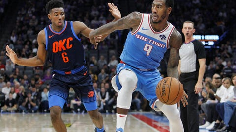<p>               Sacramento Kings guard Iman Shumpert (9) drives around Oklahoma City Thunder guard Hamidou Diallo (6) during the second half of an NBA basketball game in Sacramento, Calif., Monday, Nov. 19, 2018. The Kings won 117-113. (AP Photo/Steve Yeater)             </p>