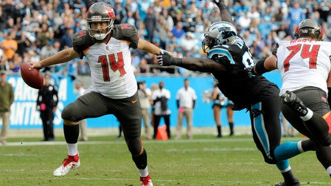 <p>               Tampa Bay Buccaneers' Ryan Fitzpatrick (14) runs past Carolina Panthers' Kyle Love (93) in the first half of an NFL football game in Charlotte, N.C., Sunday, Nov. 4, 2018. (AP Photo/Mike McCarn)             </p>