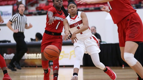 <p>               Hartford's Jordan McLemore, right, passes the ball next to Louisville's Dana Evans during the first half of an NCAA college basketball game Saturday, Nov. 24, 2018, in Las Vegas. (AP Photo/Chase Stevens)             </p>