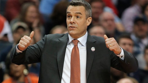 <p>               FILE - In this Friday, March 16, 2018 file photo, Virginia coach Tony Bennett signals for a jump ball during the first half of the team's first-round game against UMBC in the NCAA men's college basketball tournament in Charlotte, N.C. Bennett's fourth-ranked Cavaliers are the highest-ranked team at this week's Battle 4 Atlantis in the Bahamas. (AP Photo/Bob Leverone, File)             </p>