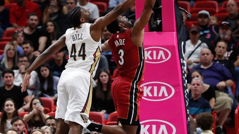 <p>               Miami Heat guard Dwyane Wade shoots against New Orleans Pelicans forward Solomon Hill in the first half of an NBA basketball game Friday, Nov. 30, 2018, in Miami. (AP Photo/Brynn Anderson)             </p>