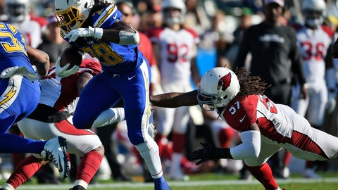 <p>               Los Angeles Chargers' Melvin Gordon (28) runs for a touchdown past Arizona Cardinals middle linebacker Josh Bynes (57) during the first half of an NFL football game Sunday, Nov. 25, 2018, in Carson, Calif. (AP Photo/Kelvin Kuo )             </p>