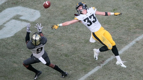 <p>               Iowa defensive back Riley Moss (33) defends againsta pass intended for Purdue wide receiver Terry Wright (9) in the first half of an NCAA college football game in West Lafayette, Ind., Saturday, Nov. 3, 2018. Wright scored a touchdown on the play. (AP Photo/AJ Mast)             </p>