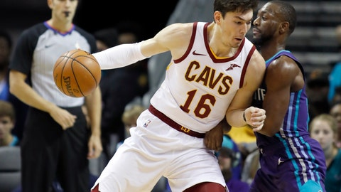 <p>               FILE - In this Saturday, Nov. 3, 2018, file photo,  Cleveland Cavaliers' Cedi Osman (16) leans a shoulder into Charlotte Hornets' Kemba Walker (15) during the first half of an NBA basketball game in Charlotte, N.C. The Cavaliers' list of injured players continues to grow. Starting forward Cedi Osman will miss at least one game with back spasms, the fourth Cleveland player sidelined by an injury. (AP Photo/Bob Leverone, File)             </p>