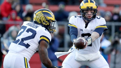 <p>               Michigan quarterback Shea Patterson, right, hands off to running back Karan Higdon during the first half of an NCAA college football game against Rutgers, Saturday, Nov. 10, 2018, in Piscataway, N.J. (AP Photo/Julio Cortez)             </p>