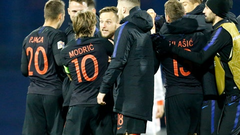 <p>               Croatia's players celebrate at the end of the UEFA Nations League soccer match between Croatia and Spain at the Maksimir stadium in Zagreb, Croatia, Thursday, Nov. 15, 2018. (AP Photo/Darko Bandic)             </p>
