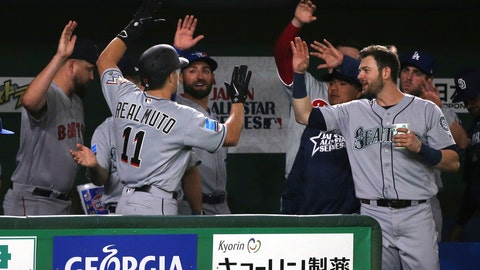 <p>               MLB All-Star's J.T. Realmuto (11) of the Miami Marlins is celebrated by teammates after hitting a solo home-run off Yomiuri Giants pitcher Ryusei Oe in the fifth inning of their exhibition baseball game at Tokyo Dome in Tokyo, Thursday, Nov. 8, 2018. (AP Photo/Toru Takahashi)             </p>
