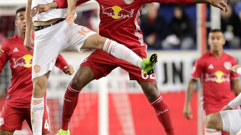 <p>               Atlanta United midfielder Miguel Almiron, left, and New York Red Bulls midfielder Tyler Adams go up for the ball during the first half of the second leg of the MLS soccer Eastern Conference championship Thursday, Nov. 29, 2018, in Harrison, N.J. (AP Photo/Julio Cortez)             </p>