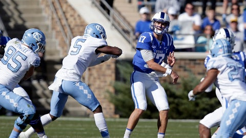 <p>               Duke quarterback Daniel Jones (17) passes as North Carolina's Tyler Powell (95) and Patrice Rene (5) pressure during the first half of an NCAA college football game in Durham, N.C., Saturday, Nov. 10, 2018. (AP Photo/Gerry Broome)             </p>