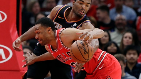 <p>               Chicago Bulls forward Jabari Parker, front, drives against Phoenix Suns forward T.J. Warren during the first half of an NBA basketball game Wednesday, Nov. 21, 2018, in Chicago. (AP Photo/Nam Y. Huh)             </p>