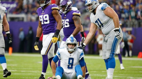 <p>               Detroit Lions quarterback Matthew Stafford (9) sits on the field after getting sacked by Minnesota Vikings defensive end Danielle Hunter (99) during the first half of an NFL football game, Sunday, Nov. 4, 2018, in Minneapolis. (AP Photo/Bruce Kluckhohn)             </p>
