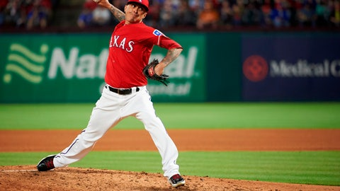 <p>               FILE - In this April 10, 2018, file photo, Texas Rangers relief pitcher Jesse Chavez pitches during the fourth inning of a baseball game against the Los Angeles Angels, in Arlington, Texas. Right-hander Jesse Chavez finalized an $8 million, two-year contract with the Texas Rangers on Friday, Nov. 30, 2018, returning to the team that traded him to the Chicago Cubs last July. (AP Photo/Cooper Neill, File)             </p>