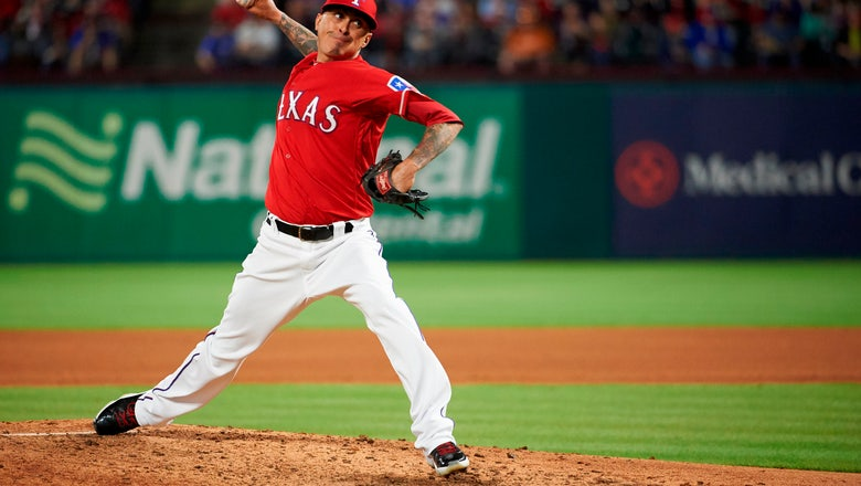 Chavez returns to Rangers, finalizes $8 million, 2-year deal