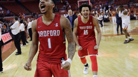 <p>               Radford guard Carlik Jones (1) and center Devonnte Holland (15) celebrate the team's win over Texas as they leave the court after an NCAA college basketball game, Friday, Nov. 30, 2018, in Austin, Texas. Radford won 62-59. (AP Photo/Eric Gay)             </p>