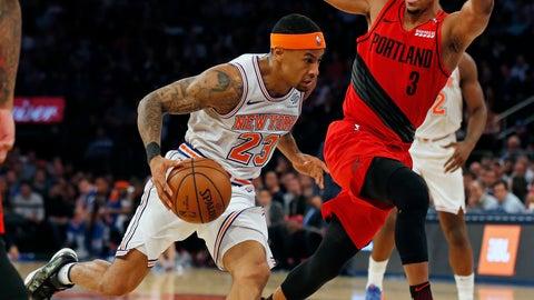 <p>               New York Knicks guard Trey Burke (23) drives to the basket past Portland Trail Blazers guard CJ McCollum (3) during the first half of an NBA basketball game Tuesday, Nov. 20, 2018, in New York. (AP Photo/Adam Hunger)             </p>