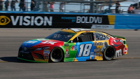<p>               Kyle Busch (18) races on lap 210 during a NASCAR Cup Series auto race on Sunday, Nov. 11, 2018, in Avondale, Ariz. (AP Photo/Rick Scuteri)             </p>