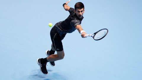 <p>               Novak Djokovic of Serbia plays a return to Alexander Zverev of Germany during their ATP World Tour Finals men's singles tennis match at the O2 arena in London, Wednesday, Nov. 14, 2018. (AP Photo/Alastair Grant)             </p>