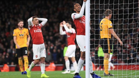<p>               Arsenal's Pierre-Emerick Aubameyang, center, rues a missed chance on goal during their English Premier League soccer match at the Emirates Stadium, London, Sunday, Nov. 11, 2018. (Mike Egerton/PA via AP)             </p>