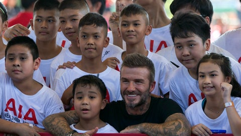 """<p>               Retired footballer David Beckham poses for a group photograph during a sponsored promotional event in Bangkok, Thailand, Saturday, Nov 3, 2018. Beckham made a brief appearance to conducted soccer drills and addressed a crowd of around a hundred young soccer fans as part of a sponsored promotional event """"AIA Football Clinic for Youth with Leading Coaches"""" that also featured coaches from Tottenham Hotspurs as well as Thai celebrities and soccer players. (AP Photo/Gemunu Amarasinghe)             </p>"""