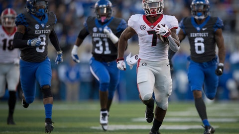 <p>               Georgia running back D'Andre Swift (7) runs for a touchdown during the second half an NCAA college football game against Kentucky in Lexington, Ky., Saturday, Nov. 3, 2018. (AP Photo/Bryan Woolston)             </p>