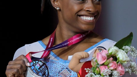 <p>               Simone Biles of the U.S. holds her silver medal after the women's uneven bars final on the first day of the apparatus finals of the Gymnastics World Championships at the Aspire Dome in Doha, Qatar, Friday, Nov. 2, 2018. (AP Photo/Vadim Ghirda)             </p>