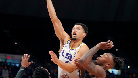 <p>               LSU guard Skylar Mays (4) goes to the basket against Memphis guard Tyler Harris (1) and forward Kyvon Davenport in the first half of an NCAA college basketball game, Tuesday, Nov. 13, 2018, in Baton Rouge, La. LSU won 85-76. (AP Photo/Gerald Herbert)             </p>