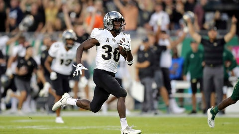 <p>               Central Florida's Greg McCrae breaks away to score a touchdown against South Florida during the first half of an NCAA college football game Friday, Nov. 23, 2018, in Tampa, Fla. (AP Photo/Mike Carlson)             </p>
