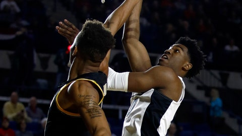 <p>               Providence guard A.J. Reeves, right, shoots over Wichita State guard Dexter Dennis in the first half of an NCAA college basketball game at the Veterans Classic tournament in Annapolis, Md., Friday, Nov. 9, 2018. (AP Photo/Patrick Semansky)             </p>