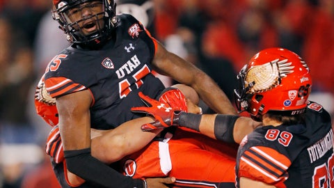 <p>               Utah quarterback Jason Shelley (15) is hosted in the air by teammates after scoring against Oregon in the second half during an NCAA college football game Saturday Nov. 10, 2018, in Salt Lake City. (AP Photo/Rick Bowmer)             </p>