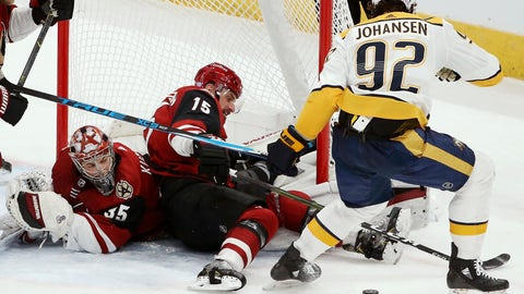 <p>               Arizona Coyotes goaltender Darcy Kuemper (35) gets some help from Coyotes center Brad Richardson (15) on a shot by Nashville Predators center Ryan Johansen (92) during the second period of an NHL hockey game Thursday, Nov. 15, 2018, in Glendale, Ariz. (AP Photo/Ross D. Franklin)             </p>