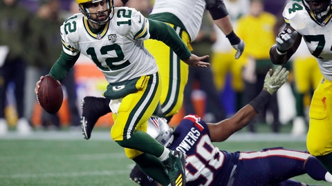 <p>               FILE - In this Sunday, Nov. 4, 2018, file photo, Green Bay Packers quarterback Aaron Rodgers (12) scrambles away from New England Patriots defensive end Trey Flowers (98) during the first half of an NFL football game in Foxborough, Mass. The Packers are hoping to bounce back from losses to the Rams and Patriots when they host the Miami Dolphins on Sunday(AP Photo/Charles Krupa, File)             </p>