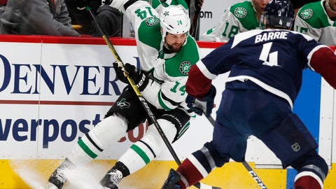 <p>               Dallas Stars left wing Jamie Benn, back, looks to pass the puck as Colorado Avalanche defenseman Tyson Barrie covers in the second period of an NHL hockey game Saturday, Nov. 24, 2018, in Denver. (AP Photo/David Zalubowski)             </p>
