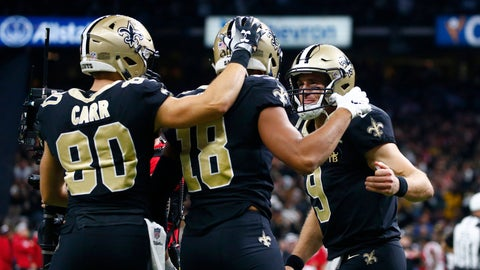 <p>               FILE - In this Nov. 22, 2018 file photo New Orleans Saints quarterback Drew Brees (9) and wide receiver Austin Carr (80) celebrate with wide receiver Keith Kirkwood (18) after Brees' touchdown pass to Kirkwood in the second half of an NFL football game against the Atlanta Falcons in New Orleans. An encouraging sign for New Orleans during its 10-game winning streak has been relatively young, inexperienced receivers winning Brees' trust. Four Saints have caught their first career touchdowns this season and all four them also have scored within the past two games. Tre'Quan Smith is the only one among them who was drafted when the Saints selected him in the third round last spring. Tight end Dan Arnold was undrafted. So were receivers Austin Carr and Keith Kirkwood. (AP Photo/Butch Dill, file)             </p>